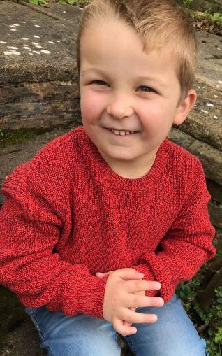 boy wearing orange sweater