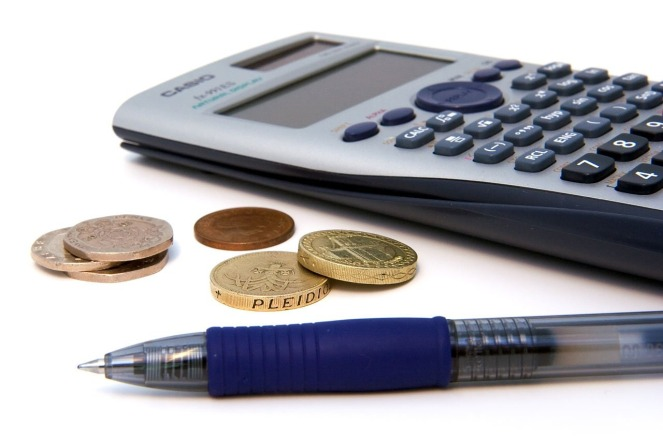 A calculator, pen and coins