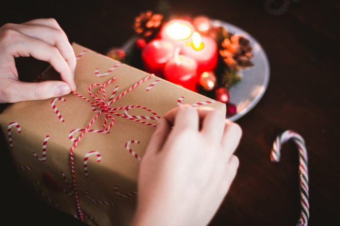 Person wrapping a Christmas gift